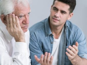 Senior man with depression and caring son